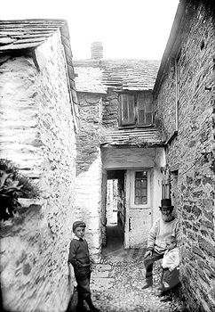 Port Isaac, North Cornwall, England, UK. Temple Bar 1906 - known as 'Squeezy Belly Alley'.