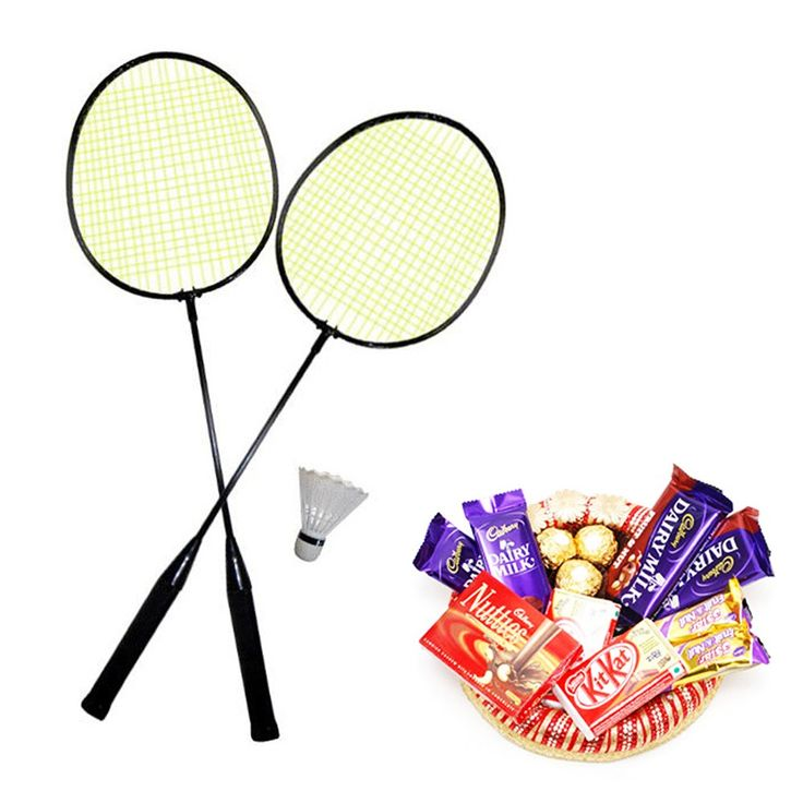 """Gift Set of Badminton Racquet with Assorted Chocolates:-  # A Car shaped Rakhi with glowing light which can later be used as Keyring.  Kit of Gift Set also includes a pack of Chawal, Mishri, Roli & Chandan.""""  # The gift set includes 1 set badminton racquet.  # Array of chocolates which includes 2 Kitkat, 2 Sneakers, 2 Dairy milk, 2 Five Star.   See detail at http://www.toygully.com/rakhi-special/7742-badminton-racquet-with-assorted-choclates.html"""
