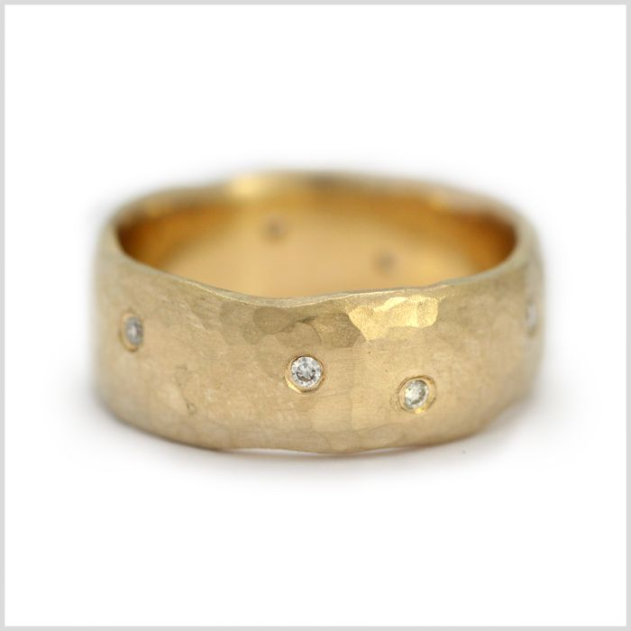 Wide Hammered Diamond Wedding Ring  | Love the organic placement of the diamonds...