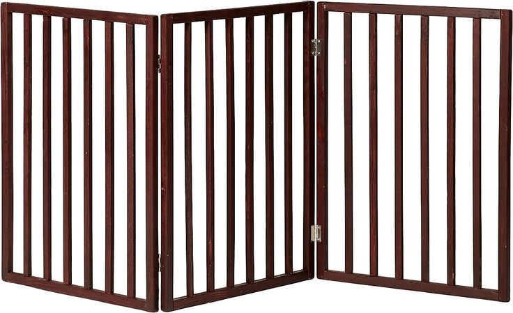 Pet Parade Pet Gate helps you keep your pet where you want him. The tri-fold gate perfectly fits to section off doorways, halls and more. It's a free standing zig-zag shape made of durable, sturdy wood that won't require any wall attachments. A great gate option for pets of all sizes, it can even keep a large dog safe and secure where you want him.