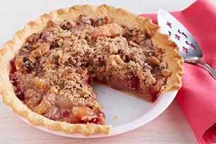 Fresh cranberries add vibrant color to canned apple pie filling. Baked in a pastry crust, the pie is topped with a crumbly cinnamon-walnut streusel.
