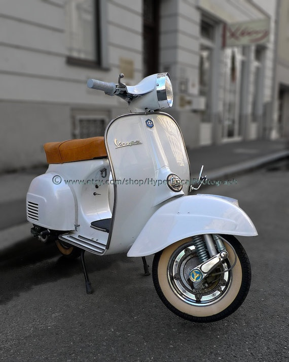 White Vespa Scooter Street Life in Linz