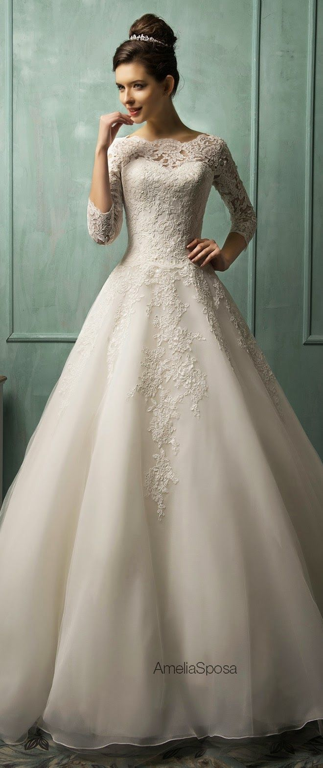 pretty traditional and modest wedding dress with 3/4 length lace sleeves and high neckline with ball gown shape #weddingcrowns