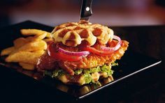 Red Robin -  honey-glazed, tempura-fried all-natural chicken breast accompanied by jalapeno relish, citrus-marinated tomatoes and onions, and shredded romaine lettuce on a Belgian waffle bun.