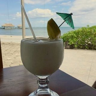 If you like Piña Colada, then you should try the one at Royal Caribbean Resort's onsite Bar and Restaurant, Island Time. See you there!  #pinacolada #pinapple #piñacolada #drinksonthebeach #drinks #drinks #drink #drinking #drinkup #alcohol #drunk #straw #miniumbrella #coconut #cocktail #pinapple #beachbar #barandgrill #barandrestaurant #instatravel #instadrink #instadrunk #discoverbelize #drinkporn #foodanddrink #tropicaldrinks #cocktailtime
