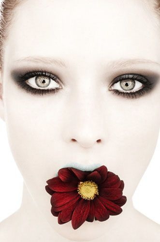 I like this photograph by Rankin because of the colors, the colors used are very different- her face is very light and pale, whilst the flower is very bright and colorful. the mood and feel of the image is serious because of her blank facial expression.