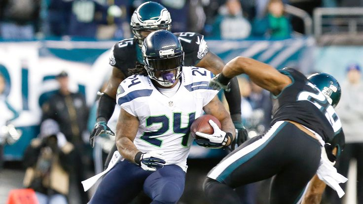 Russell Wilson threw two touchdown passes, ran for another score and the Seattle Seahawks stifled Philadelphia's high-powered offense in a 24-14 victory over the Eagles on Sunday.