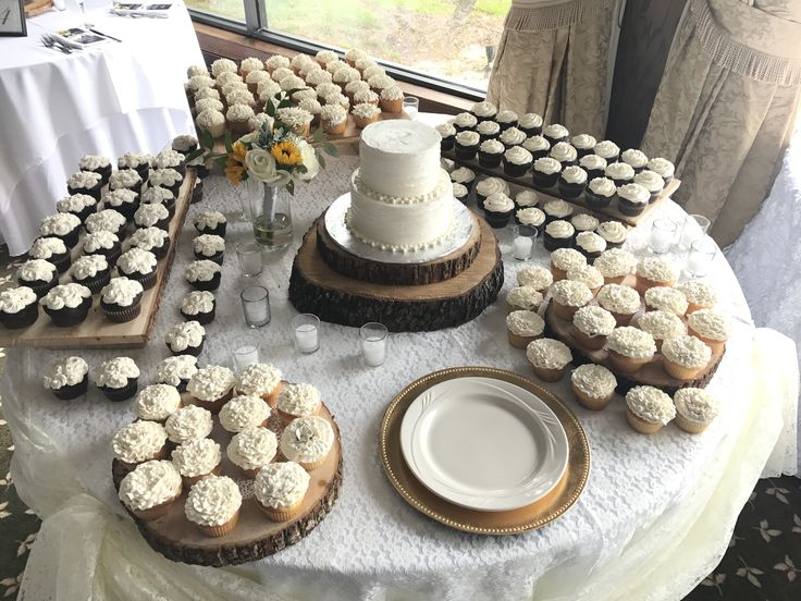 Flower wedding cupcake display.  Wedding Cupcakes delivered to The Rusty Pelican in Tampa, Florida