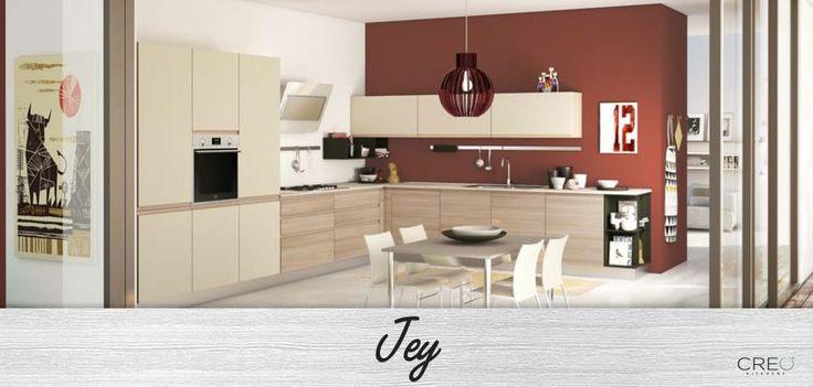 La cucina Jey, con le maniglie che nascono dalla sagomatura dell'anta, offre un design essenziale e funzionale, valorizzato dalle essenze legno armonizzate con tinte unite. #CREO #casa #home #cucina #living #arredamento