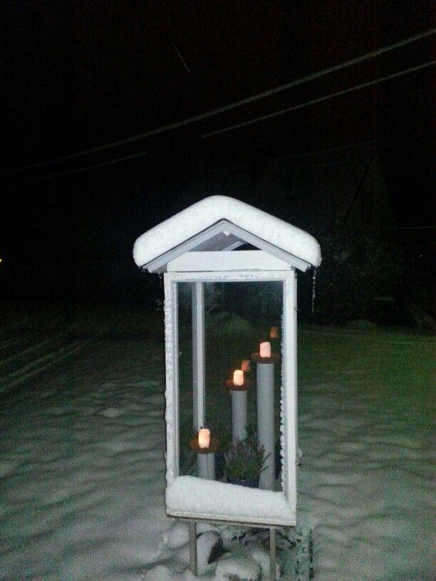 Kynttilälyhty talvella