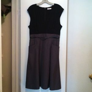 "Calvin Klein Black Cross top  with small capped sleeves Fit and Flare dress and gray skirt with pockets and skinny black belted above waist. Polyester & Rayon.  Dress length 43"" from shoulder.  Measurements across hip width 23"", bust 21"", waist 17"" and 35"" across bottom of hemline. $45"