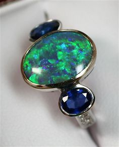 http://rubies.work/0193-ruby-rings/ 0592-emerald-rings/ opal and sapphire ring - Google Search                                                                                                                                                      More