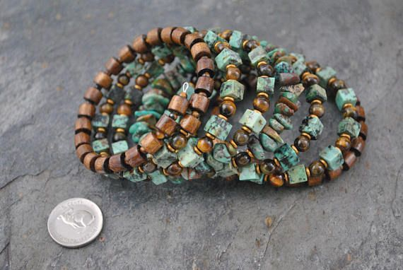 Tribal Style African Turquoise & Golden Blue Tiger Eye Seven Strand Memory Wire Bracelet #memorywire #seven #sevenstrand #tribal #tribalstyle #bohemian #artisan #artisanbracelet #oneofakind #handmade #gemstone #african #turquoise #africanturquoise #golden #goldentigereye #tigereye #wood #wooden #czech #czechglass #cuff #memorywirecuff #natural #unique #statement