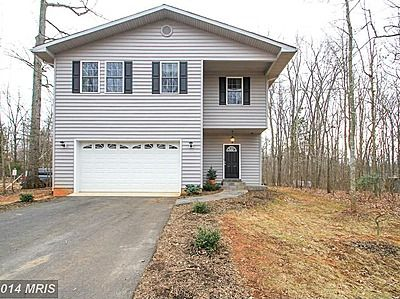3116 Lakeview Pkwy, Locust Grove, VA 22508 $329,000 4 beds 4 baths 1130 sqft CUSTOM built home located on PRIVATE, WOODED, corner lot. Beautiful WATER VIEW with spectacular SUNSETS in a GATED community! EUROPEAN, minimalist style with wide plank HARDWOOD floor entire main level. Gourmet kitchen, Black Galaxi GRANITE COUNTERS, SS Appliances, clean contemporary cabinets, accented by interior BRICKWALL! Community offers water sports, sandy beaches, marina, golf + MORE!