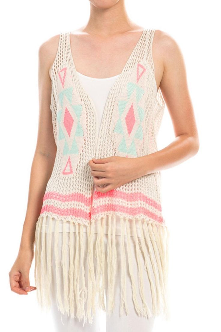 Aztec fringe knit vest. Beige vest with colorful print. This knit vest is just begging to be worn to a music festival!     Kylie Fringe Vest by The Classic. Clothing - Jackets, Coats & Blazers - Vests Delaware