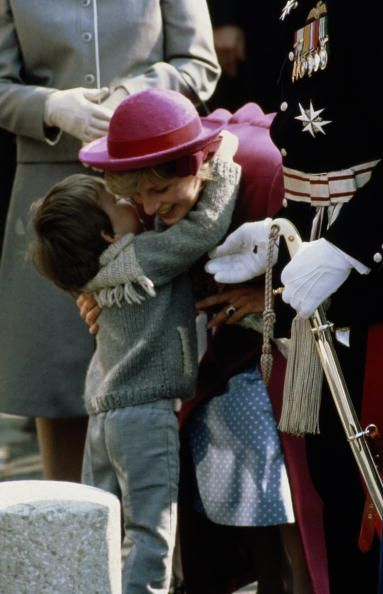 "April 2, 1982: Princess Diana on a walkabout during the opening of the Hundred Harmonies Pagoda at Chinatown Community centre, Liverpool. Three year old, Colin Griffiths threw his arm around the Princess and told her, ""I love you."""