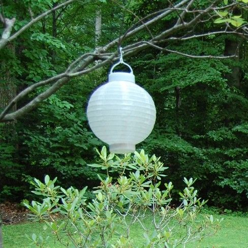 """Add a sophisticated touch to your outdoor decor with these round nylon solar powered lanterns. They are 8"""" round with hangers. Each has a built-in solar panel, an on/off switch, and comes with 1 rechargeable battery. These outdoor lanterns collect direct sunlight all day, and will glow up to 6-7 hours."""