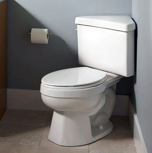 Corner toilet!? Genius. A toilet with a triangular tank can save a lot of space in a small bathroom.