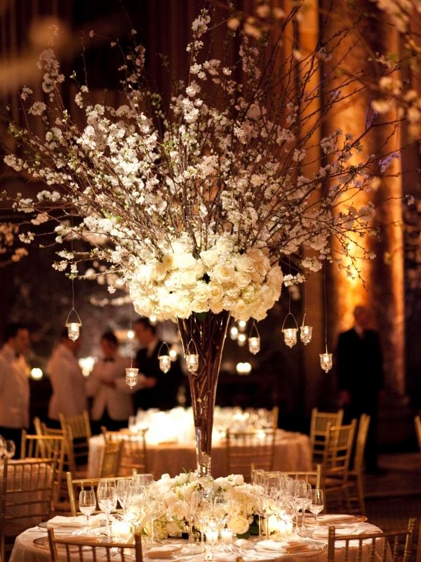 church wedding decorations candles%0A Get Inspired  These delicate white flowers and branches with hanging candles  make for an absolutely stunning winter wedding centerpiece  don u    t you think