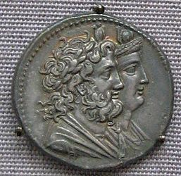 Isis and Serapis Silver coin, 3rd century BCE. Hellenized version of Osiris & Apis bull. Cult inaugurated in Alexandria by Ptolemy.London: British Museum. Credits: Ann Raia, 2006.