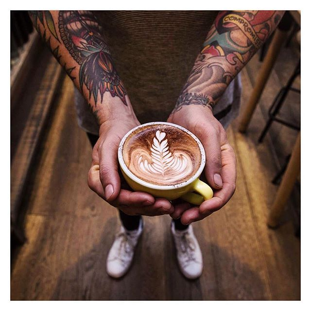 Coffee from Lucky Penny in Windsor. Arm Tattoos. Latte Art. Rosetta