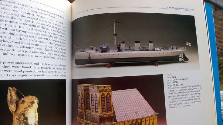 VIDEO Bing Germany 41in. clockwork boat from book battleship inc book key cradle