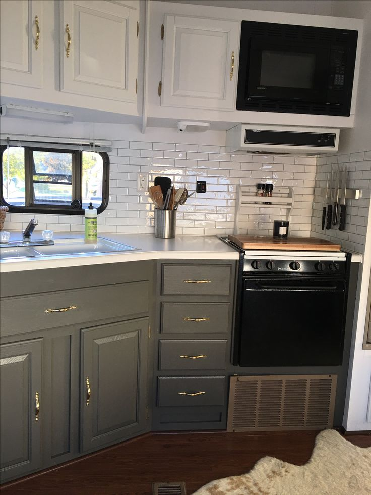 Cabinet idea: white top cabinets with bottom cabinets painted a deep purple or orange.