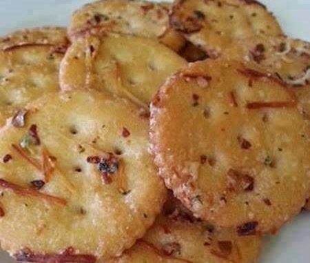 1 stick melted butter, 1 packet Ranch dressing mix, ¼ c. grated Parmesan, 1 tbsp. red pepper flakes 1 tsp. garlic powder. 1 box Ritz crackers ~Directions toss box of Ritz crackers with all 5 ingredients Bake in 300 degree oven for