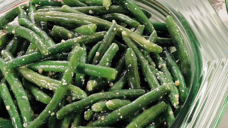 Frozen green beans take a festive twist when you add a zesty Parmesan sauce that takes just minutes to prepare.
