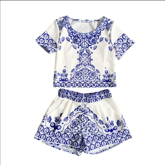 Crop top and shorts set White and blue crop top and shorts set. Tag says size medium but runs small . Will fit a size small. Worn once but too small for me. Other