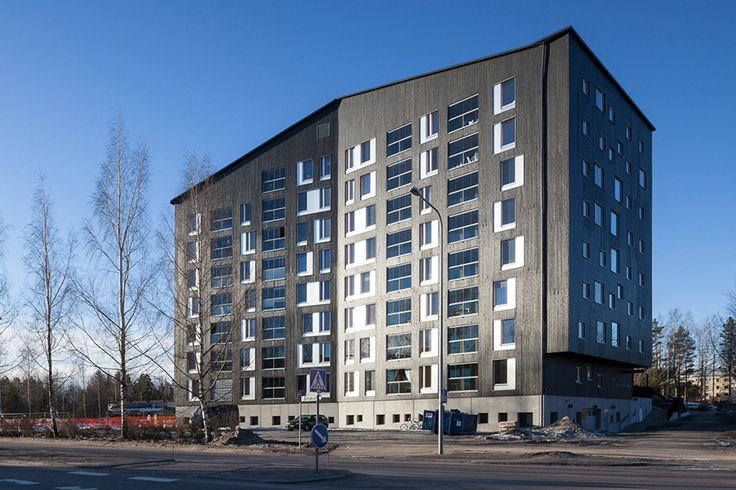 Puukuokka Housing Block is an energy-efficient trio of multi-story timber-framed flats in the Jyväskylä suburb of Kuokkala