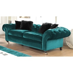 I wish I had a velvet turquoise sofa like this one here :-)