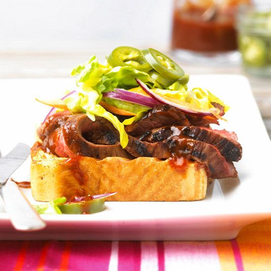 Tri-tip steak, romaine lettuce, slivered onion, and spicy jalapenos are piled high on a piece of Texas toast! More of our best grilled steak recipes: http://www.bhg.com/recipes/grilling/Steak/grilled-steak-recipes/?socsrc=bhgpin080713texastoast=10