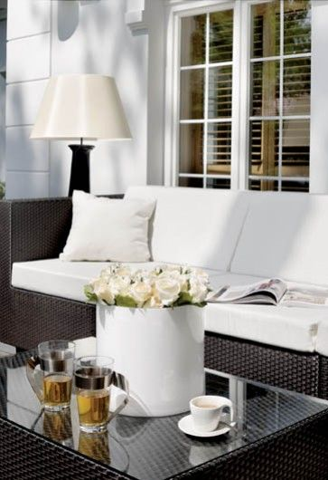 white roses in white cylinder pot | lovely idea for the patio/terrace too