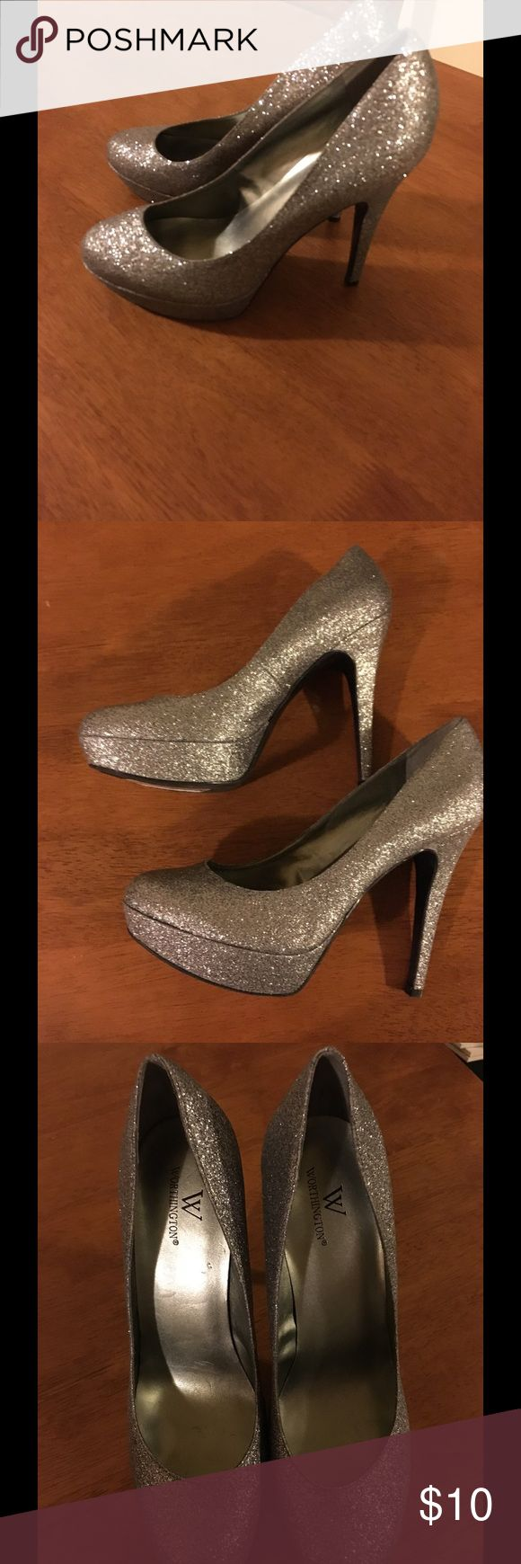 Worthington Size 9.5 Silver Glitter Heels Bought at Clothes Mentor but too small.  I can't get sticker off bottom but shoes are excellent condition!   Worthington silver glitter heels.  Size 9.5.  Important:   All items are freshly laundered as applicable prior to shipping (new items and shoes excluded).  Not all my items are from pet/smoke free homes.  Price is reduced to reflect this!   Thank you for looking! Worthington Shoes Heels