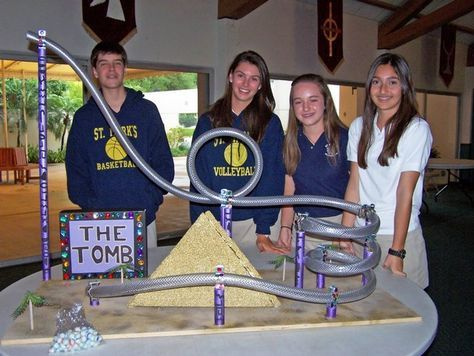 Teams of eighth grade students designed and built model roller coasters for their physics project.  Team members (l-r):  Jordan Oregero, Ali Buttelman, Sarah Shilling, McKenna Phillips, and Christopher Vertucci (not pictured) built an Egyptian-themed coaster.