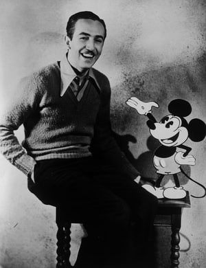 Walt Disney: American animator and producer Walt Disney with one of his creations, Mickey Mouse. (1935)