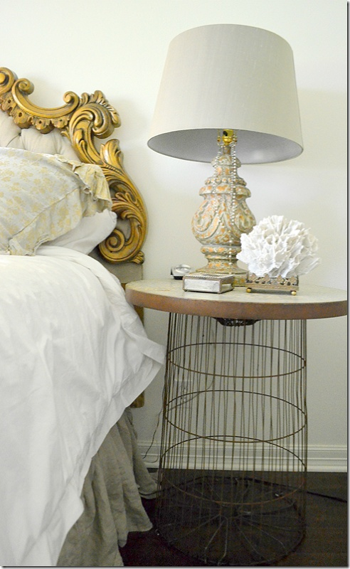 Old wire trash can becomes the base for a bed side table from COTE DE TEXAS: A Reader's House