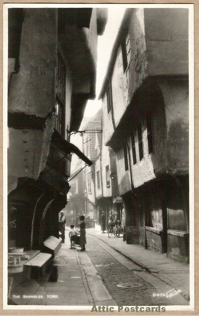 Vintage real photo postcard of The Shambles in York, Yorkshire, England.