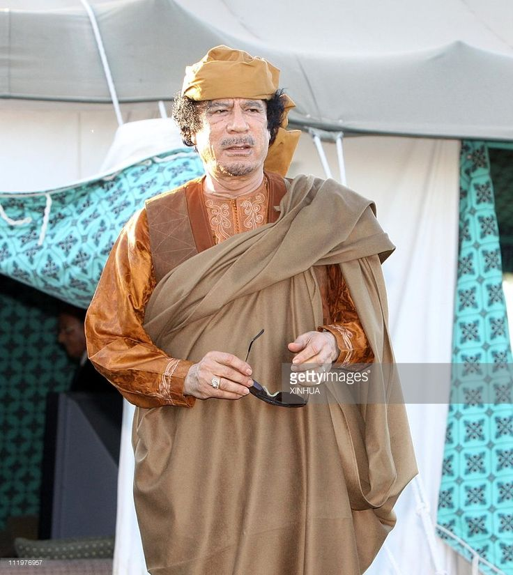 Libyan leader Muammar Gaddafi stands outside his tent during his meeting with the African delegation, who arrived in Libya to try to negotiate a truce between Kadhafi's forces and rebels seeking to oust him, April 10, 2011. in Tripoli, capital of Libya. Libyan leader Muammar Gaddafi has reportedly accepted the African Union's 'road map' to end conflicts in the country.