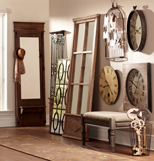 Update the look of any boring wall with a mixture of wall clocks and mirrors in all shapes and sizes. #decor HomeDecorators.com