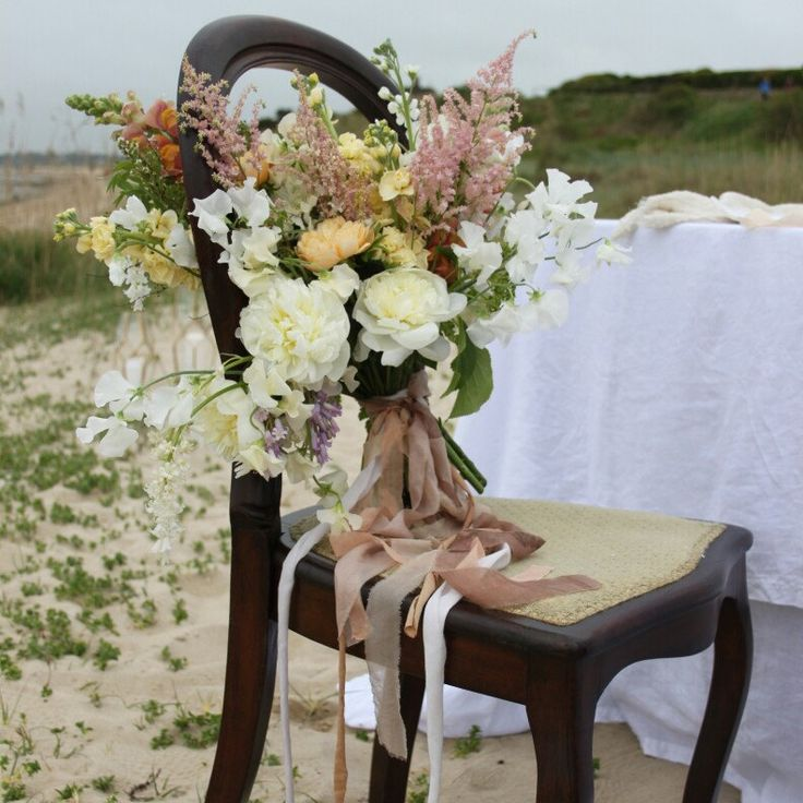 Loads of trailing silk ribbons to add drama, texture and mysterious magic to this whismical beach wedding shoot