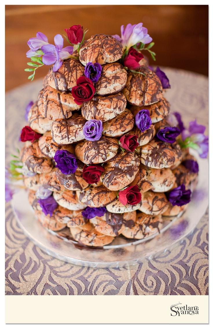 A tower of chocolate covered cream puffs was a wonderful alternative to traditional wedding cake as well as a tasty treat. Guests could just pull off a cream puff versus having to pay a cake cutting fee to the venue. (Photo credit: Svetlana Yanova)