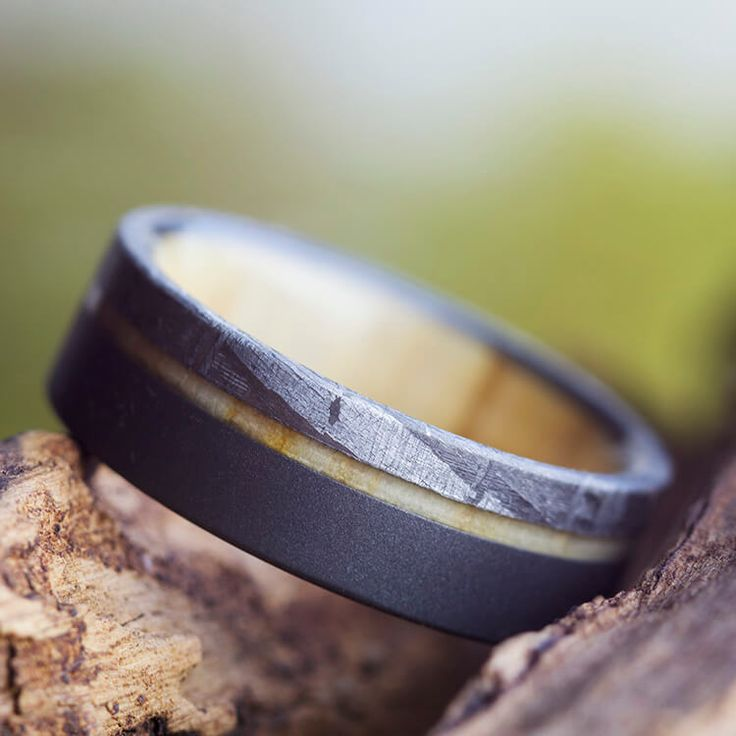 Check out this seriously cool Meteorite wedding band with Sandblasted Titanium and an Aspen Wood sleeve. See more here: https://www.etsy.com/listing/514656148/sandblasted-meteor-ring-aspen-wood?ref=shop_home_active_29?utm_source=Wedding-Chicks&utm_medium=Inspo-Post-2608&utm_campaign=Inspo-Post-May