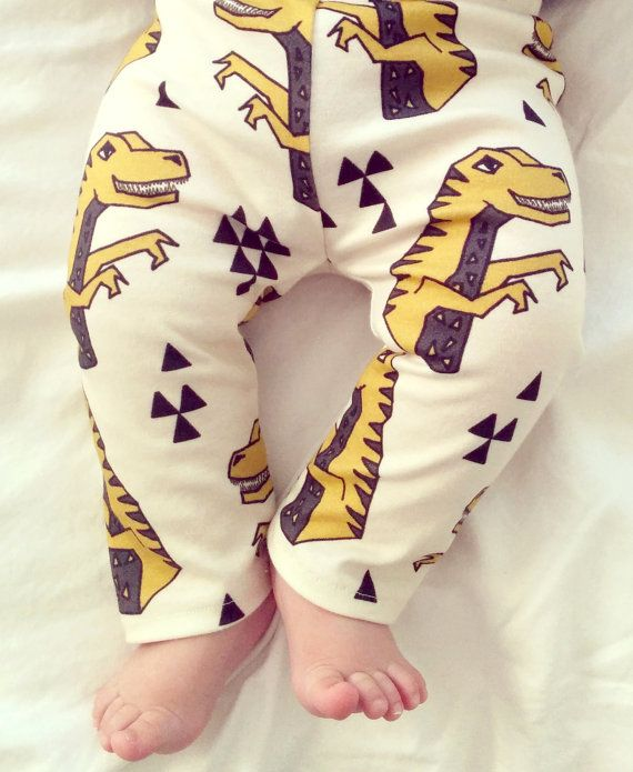 Design: mustard dinosaurs on cream      //// Description ///// • Soft, organic cotton-knit baby leggings. • These stylish baby leggings coordinate