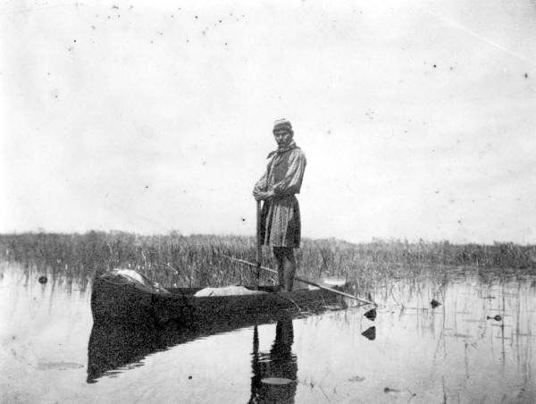 Seminole in dugout canoe - Everglades, Florida.