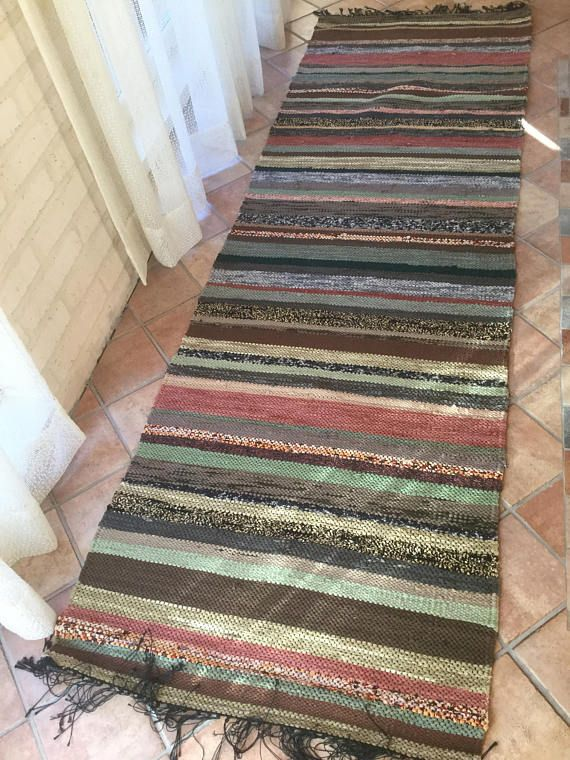 Blue Rag rug with earthy colour stripes