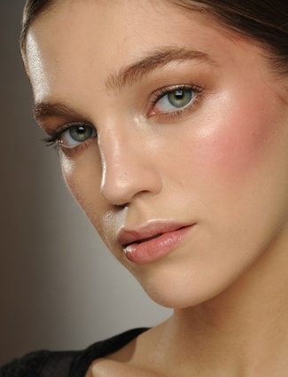 Make up needs to look natural; use only a light cover of foundation, minimal eye make up and a little bit of lip gloss.