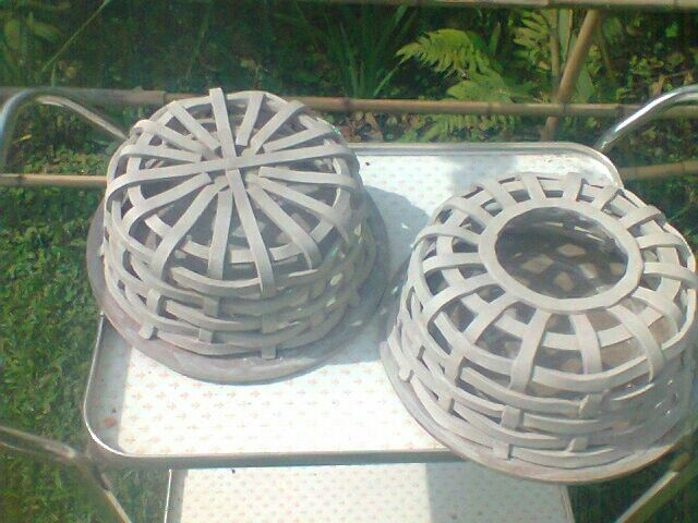 Bottom vesion of wooven planters at green ware form