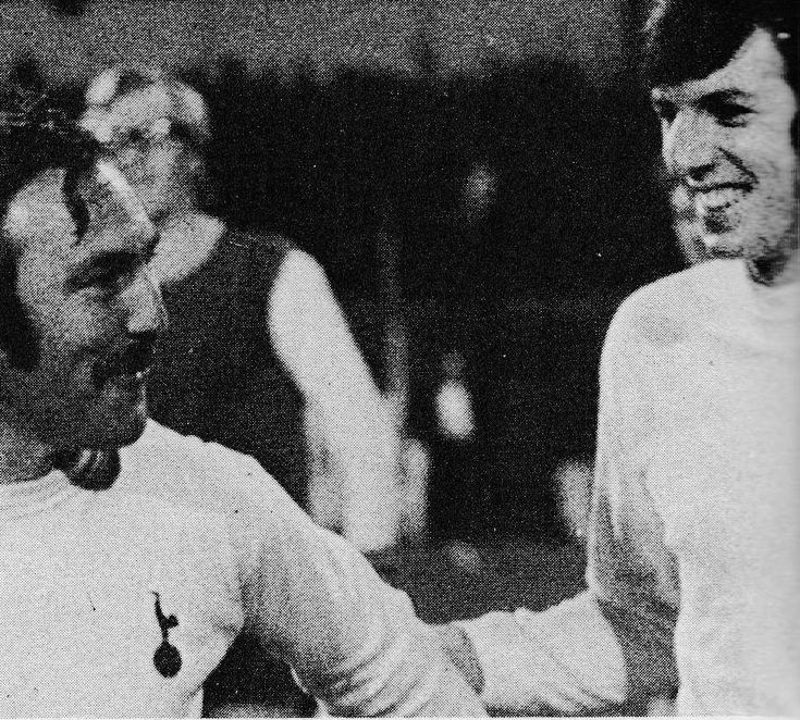 18th October 1972. Tottenham Hotspur captain Martin Peters pushes legend Jimmy Greaves in to leading the side out for his testimonial against Feyenoord, at White Hart Lane.